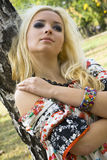 Young woman blonde on a background trees in a park Stock Images