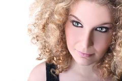 Young woman with blonde curly hair Stock Images