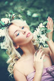 Young Woman with Blonde Curly Hairstyle and Flowe Stock Photos