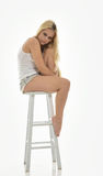 Young woman blonde female model in white tank and denim Stock Image