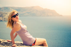 Young Woman blonde hair relaxing outdoor Royalty Free Stock Photography