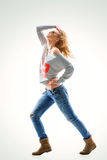 Young woman blonde in t-shirt and jeans. Beautiful young woman blonde in t-shirt and jeans on Royalty Free Stock Photo