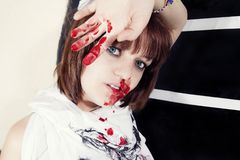 Young woman with bloody face Royalty Free Stock Images