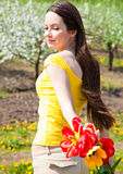 Young woman in blooming garden Stock Photos