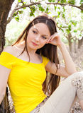 Young woman in blooming garden Stock Photo