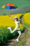 Young woman on blooming rape field in summer Royalty Free Stock Photos