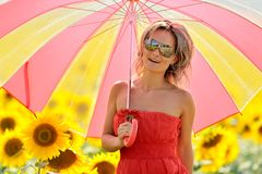 Young woman on blooming sunflower field Royalty Free Stock Images