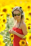 Young woman on blooming sunflower field Stock Photo