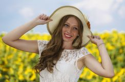 Young woman on blooming sunflower field Royalty Free Stock Photo