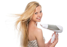 Young woman blow-dry Stock Image