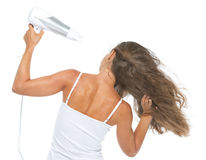 Young woman blow-dry . rear view Stock Image