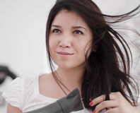 Young woman blow drying her hair Royalty Free Stock Photo