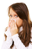 Young woman blow one's nose Royalty Free Stock Photos