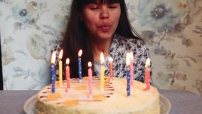 Young woman blow out candles on birthday cake, anniversary celebration. And happy birthday concept stock video