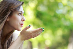 Young Woman Blowing A Kiss Stock Image