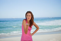 Young woman blowing an air kiss on the beach Stock Photo