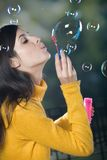 Young woman blowing bubbles. Outdoors Stock Images
