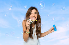 Young Woman Blowing Bubbles Stock Photo