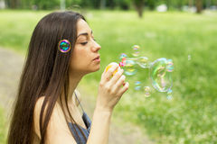 Young Woman Blowing Bubbles Royalty Free Stock Photos