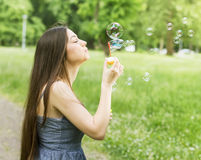 Young Woman Blowing Bubbles Royalty Free Stock Image