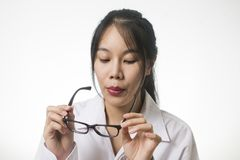 Young woman blowing dust from her glasses. Clean glasses Stock Images