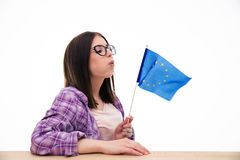 Young woman blowing on the europian flag Stock Photography