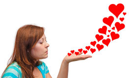 Young woman blowing hearts Stock Image
