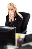 Young woman blowing her nose at office. Young woman blowing her nose with kleenex at office. Isolated over white background stock photos