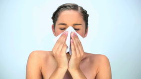 Young woman blowing her nose stock footage