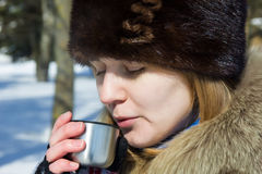 Blowing on a hot tea royalty free stock images