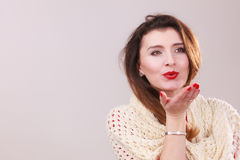 Young woman blowing kiss. Royalty Free Stock Photo