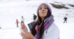 Young woman blowing a kiss at the camera Stock Photos