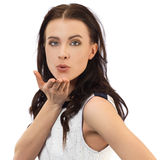 Young woman blowing a kiss. Studio shot Royalty Free Stock Images