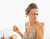 Young woman blowing on nails after applying nail polish Stock Images