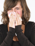 Young Woman Blowing Nose Stock Photo