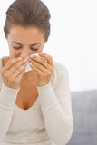 Young woman blowing nose Stock Image