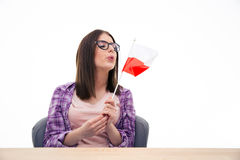 Young woman blowing on the Polish flag Stock Images