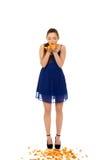 Young woman blowing rose petals. Beautiful teenage woman blowing rose petals Royalty Free Stock Photography