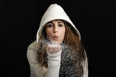 Young woman blowing snow Stock Images