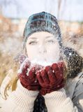 Young woman blowing snow Stock Photography