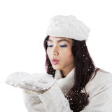 Young woman blowing snow in studio Stock Image