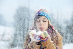 Young woman blowing snow to away. Winter collection: young woman blowing snow to away Royalty Free Stock Photography