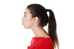 Young woman blowing on something Royalty Free Stock Images