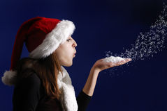 Young woman blowing star dust Stock Image