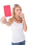 Young woman blowing whistle and holding red card. Portrait of young woman blowing whistle and holding red card on white background Stock Photo