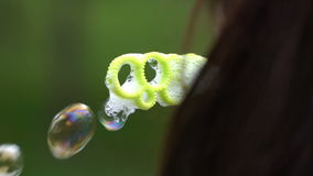 Young woman blows bubbles. stock footage
