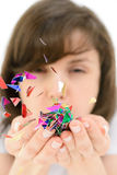 Young woman blows confetti with palms Stock Images