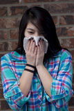 Young woman blows her nose. Royalty Free Stock Images
