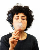 Young woman blows smoke Stock Photos