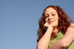 Young woman on blue Royalty Free Stock Photo